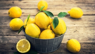 Fresh lemons on the rustic tale